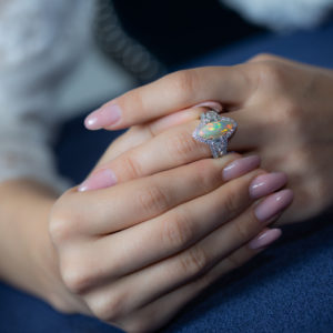 Diamond ring with marquise shaped opal and diamonds